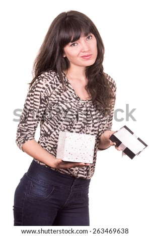 beautiful young disappointed girl holding present wrapped in a box isolated on white - stock photo