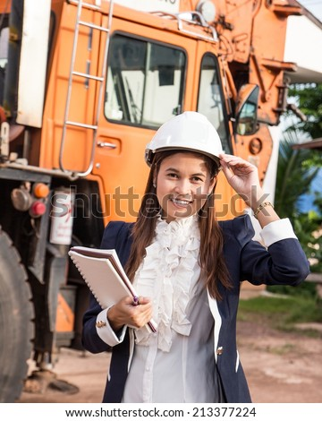 Beautiful young engineer wearing a helmet. - stock photo