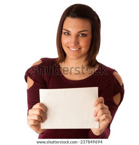 Beautiful young excited successful woman with short brown hair pointing into blank card for promotional purpose isolated over white - stock photo