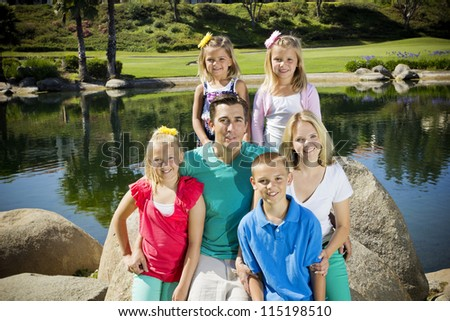 Beautiful Young Family Portrait - stock photo