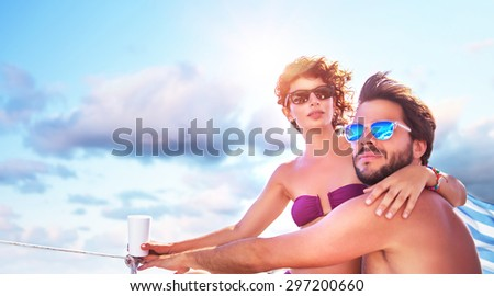 Beautiful young family spending hot summer days on the sailboat, traveling along sea, romantic relationship, enjoying honeymoon - stock photo