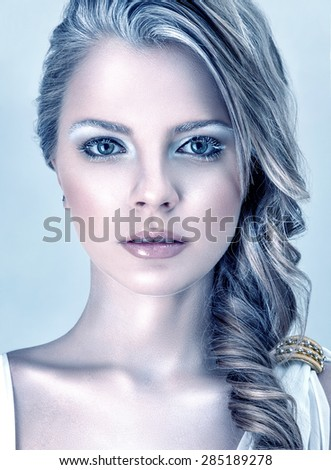 Beautiful young fashion model with winter ice style makeup