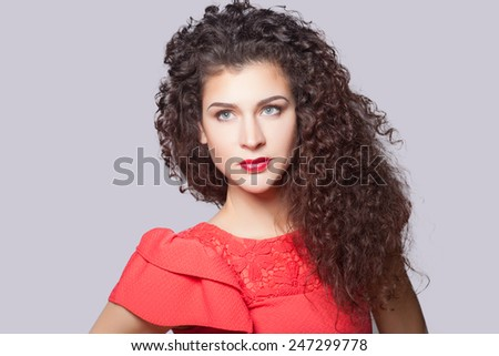 Beautiful young fashion woman with long curly hairs - stock photo