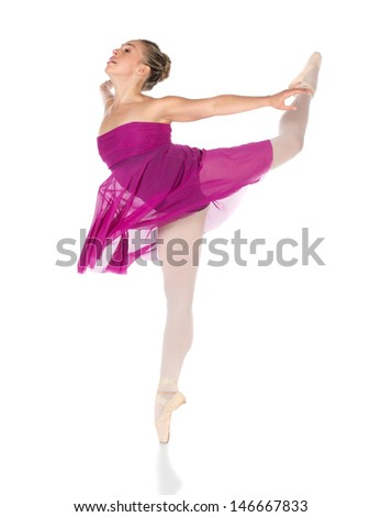 Beautiful young female classical ballet dancer on pointe shoes wearing a black leotard pink stockings and purple dress isolated on a white studio background