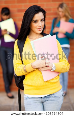 beautiful young female college student portrait - stock photo