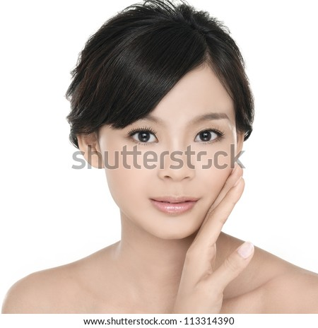 Beautiful young female face with a wellness complexion - stock photo