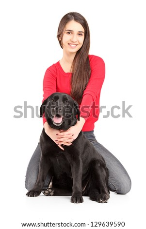 Beautiful young female hugging her dog - stock photo