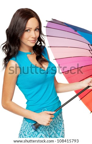 Beautiful young female in bright summer clothing opening umbrella, against white background