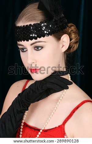 Beautiful young female in 1920 style attire  - stock photo