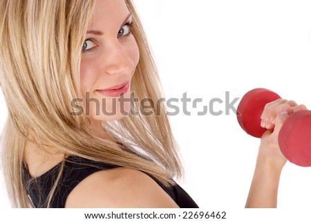 beautiful young female looking up while exercising with a barbell - stock photo