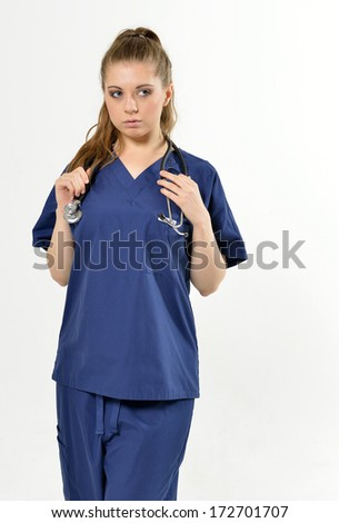 Beautiful young female medical professional with stethoscope - studio