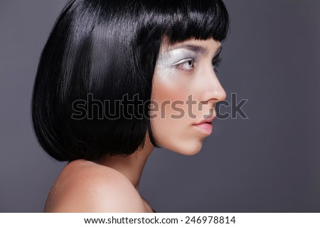 Beautiful young female model with silver eyeshadow - stock photo