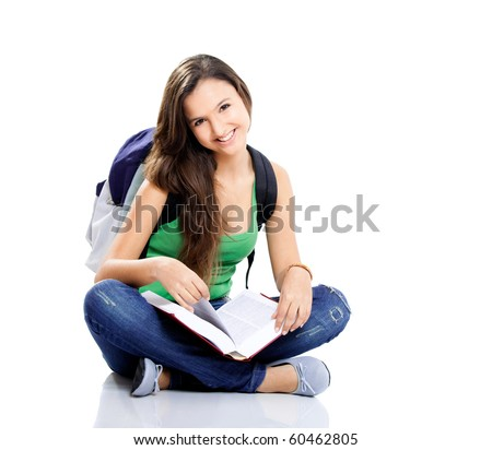 Beautiful young female student sitting on floor studying, isolated on white