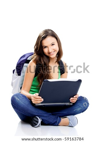 Beautiful young female student sitting on floor studying on a laptop, isolated on white - stock photo