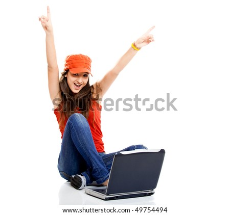 Beautiful young female student with a laptop, isolated on white - stock photo
