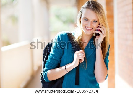 beautiful young female university student talking on the smart phone - stock photo