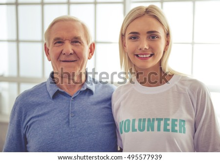 Beautiful Young Female Volunteer Handsome Old Stock Photo