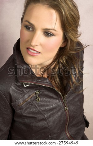 Beautiful young female wearing a leather jacket