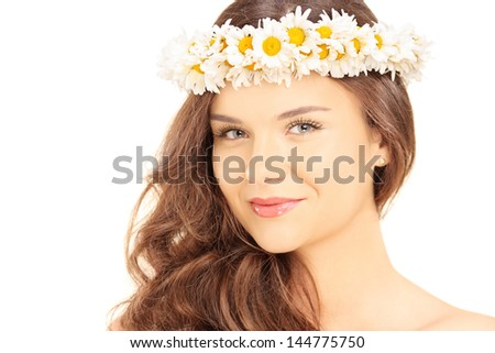 Beautiful young female with a daisy hair wreath looking at camera isolated on white background - stock photo