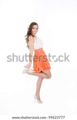 beautiful young female with orange skirt in white background