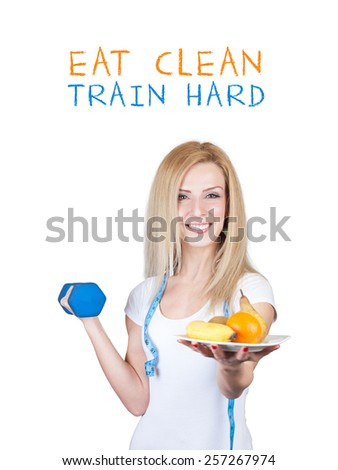 Beautiful young fitness model woman with a plate full of Fruits Vegetables and dumbbell (weight) - Weight loss diet - Isolated on white background with place for your text - stock photo