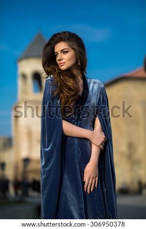 beautiful young Georgian girl near old castle - stock photo