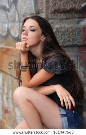 beautiful young girl against old wall