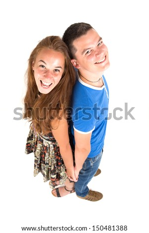 Beautiful young girl and handsome boy with a funny side view - stock photo