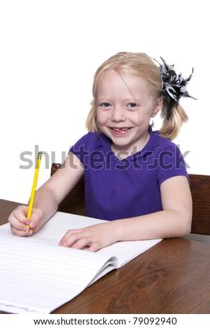 Beautiful Young Girl Doing Homework - stock photo