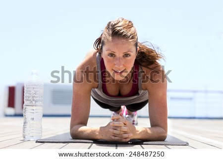 Beautiful young girl doing plank - stock photo