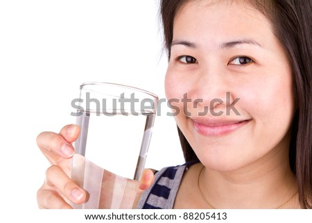 Beautiful young girl drinks water from glass on white back ground