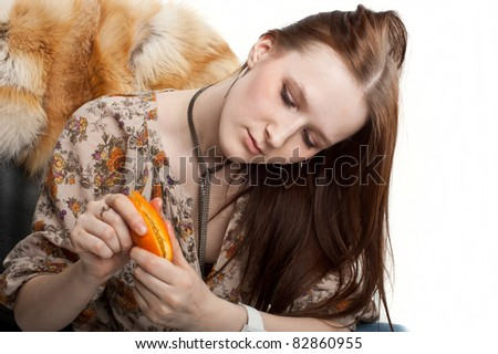 beautiful young girl eating fruit, isolated over white