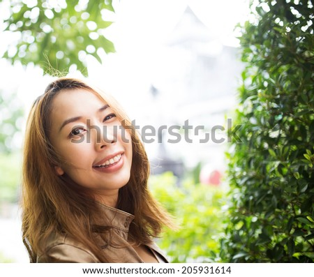Beautiful young girl  enjoying the summer  outdoors in the city's park - stock photo