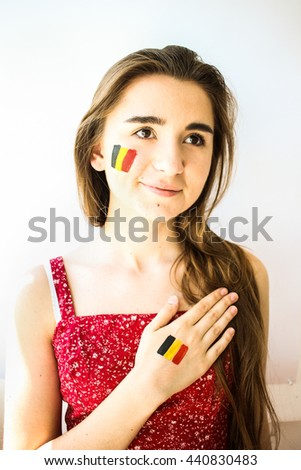 Beautiful young girl football fan with belgian flag singing anthem