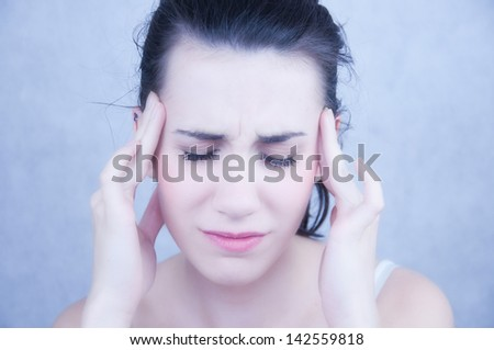 Beautiful Young Girl Having Headache - stock photo
