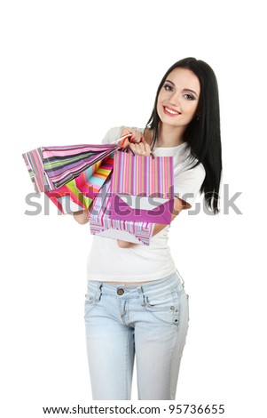 beautiful young girl holding bright bags isolated on white