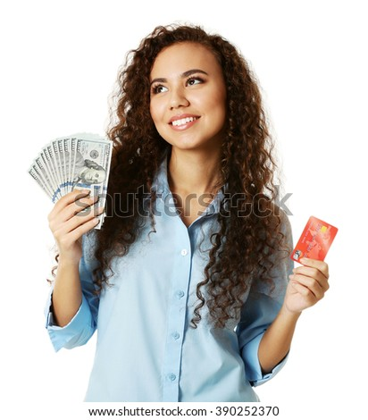 Beautiful young girl holding cash and credit card, isolated on white