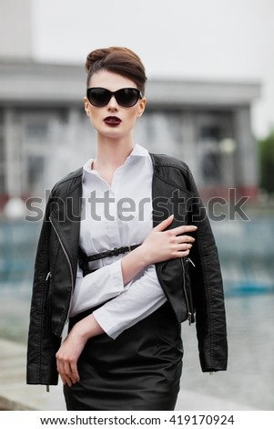Beautiful young girl in a black blazer