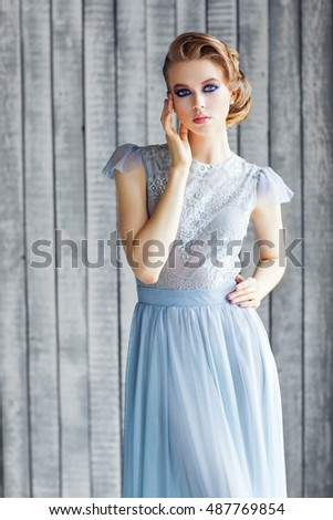 Beautiful young girl in a blue dress