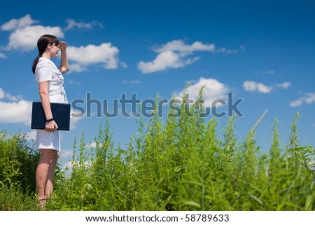 beautiful young girl in a business suit in an outdoor