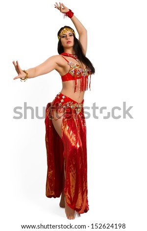 Beautiful young girl in a red suit oriental dance in motion isolated on white background - stock photo