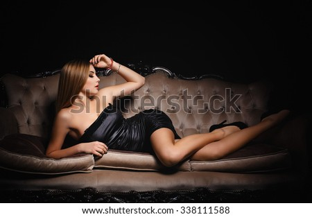 Beautiful young girl in a sexy black dress - stock photo