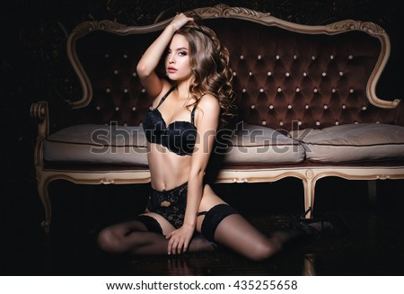 Beautiful young girl in a sexy lingerie - stock photo
