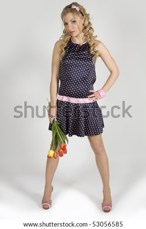 Beautiful young girl in a shot dress with tulip