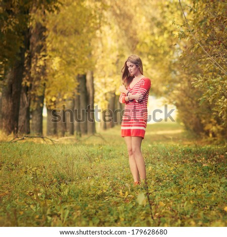 beautiful young girl in a sunny park - stock photo