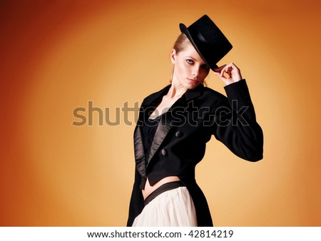 beautiful young girl in a tuxedo - stock photo