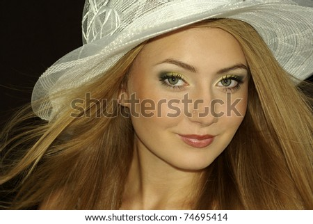 beautiful young girl in a white hat