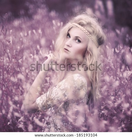 beautiful young girl in a wonderful place. photos in violet tones - stock photo