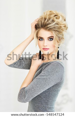 Beautiful young girl in gray dress