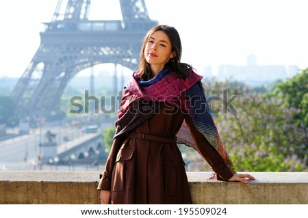 Beautiful young girl in Paris on a sunny summer day - stock photo